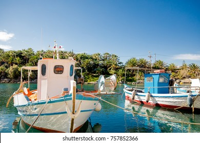 Boats in the harbor of the lovely village Sissi (Crete, Greece)