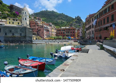 Boats in the harbor of Vernazza, one of the famous cinque terra mountain villages with colorful houses, tourist attraction on the Mediterranean sea coast in Liguria, Italy