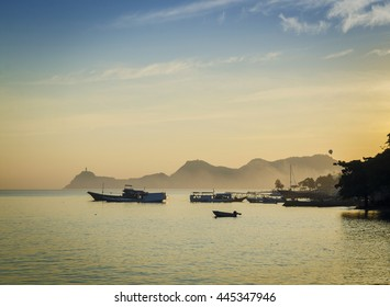 boats at harbour in dili coast east timor at sunset