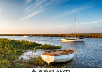 Boats at high tide on salt marshes at Blakeney on the north Norfolk coast