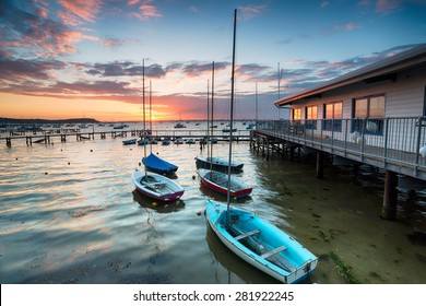 Boats at high tide at Sandbanks in Poole Harbour in Dorset