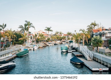 Boats and houses along a canal in Naples, Long Beach, California