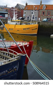 Boats and houses in Eyemouth, old fishing town in Scotland, UK. 07.08.2015