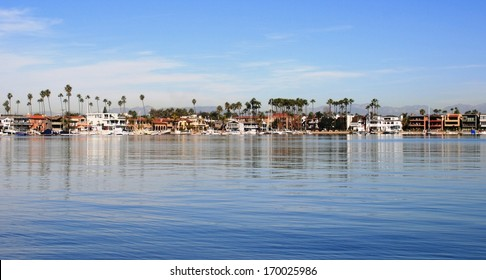 Boats and houses on the shore of Naples Island, Long Beach, CA