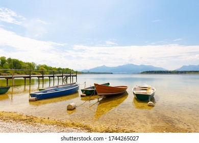 boats at lake Chiemsee with alps in background