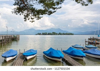 Boats at lake Chiemsee with view to the Fraueninsel island, Germany