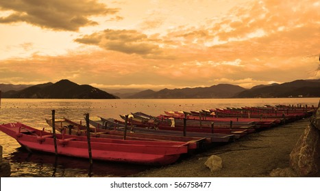 Boats in the lake during sunset.