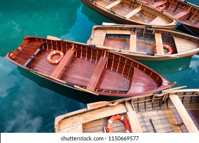 Boats and lifebuoy on the lake. Braers lake in the Dolomites alps, Italy. Beautiful composition as a background