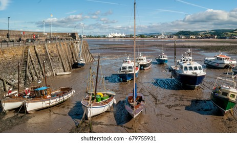 Boats at low tide in Minehead harboard,  Minehead, Somerset, UK.