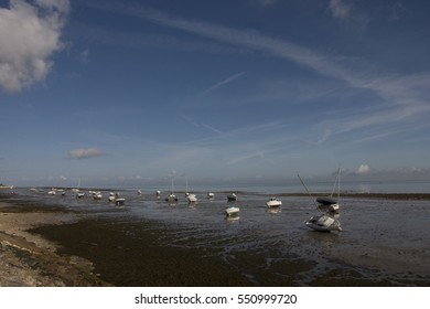 Boats at low tide on the shoreline at Il de Re.