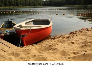 Boats, marina and calm lake