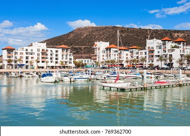 Boats at the Marina harbour in Agadir town. Agadir is a major city in Morocco located on the shore of the Atlantic Ocean, near the Atlas Mountains.