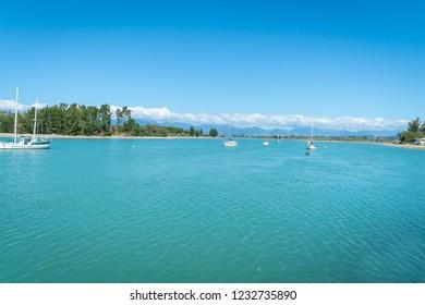 Boats moored in beautiful Waimea Estuary at Mapua on Tasman Bay with yacht moored center.