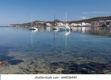 Boats moored in clear calm water