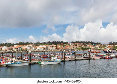 Boats moored to the dock at Xufre fishing port of Arousa Island