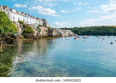 Boats moored in Fowey Estuary at beautiful Cornish harbour town Fowey in South Cornwall, England