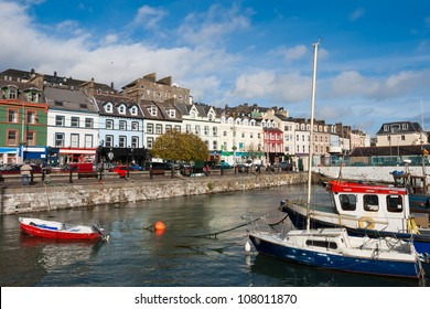 Boats moored in a harbor, Cobh, County Cork, Ireland
