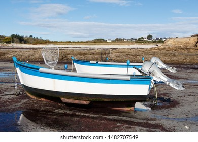 Boats moored in the harbor of Primelin at low tide