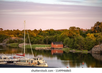 Boats moored at the inlet at Kökar, a municipality of the Åland Islands, Finland, a few minutes before sunset, a few days after midsummer, and two days before the full moon.
