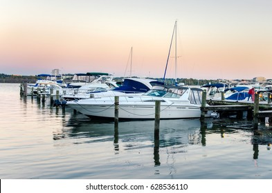 Boats moored to a Jetty on the Potomac River at Dusk. Alexandria, Virginia