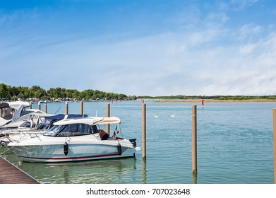 Boats moored in the lagoon harbor. Bibione, Italy