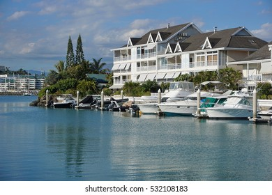 Boats moored in a marina with apartments, Noumea city, Orphelinat bay, Grande Terre island, New Caledonia, south Pacific