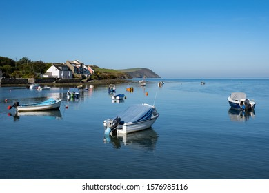 Boats moored in Newport bay in Pembrokeshire on a summers day.