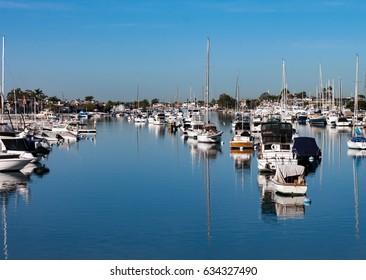 boats moored in Newport Beach Harbor California on a sunny day