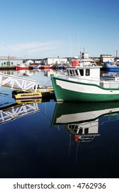 Boats moored at the wharf in Bonavista, Newfoundland, Canada - travel and tourism.