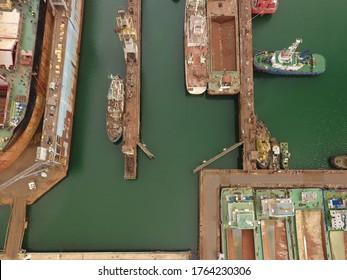 boats in mooring. repair vessels hull  (ship, tanker) in shipyard
