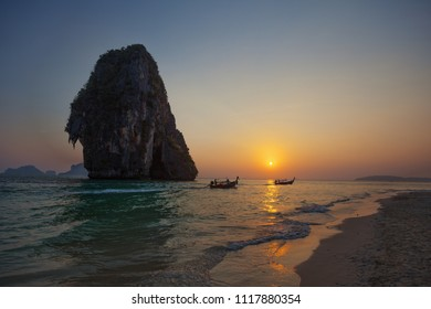 Boats move by the sea during the evening sunset. Thailand