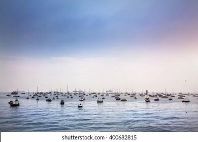 Boats in Mumbai Harbor at blue sky, Maharashtra, India