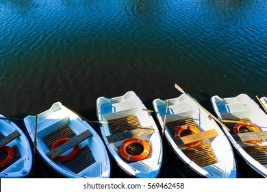 Boats near the pier. Moored skiff. Orange Lifebuoy