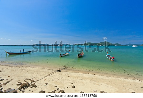 Boats near  shore waiting for tourists, Thailand. Beautiful tropical landscape.