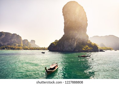 Boats near tropical islands at sunny day in Andaman Sea, Thailand