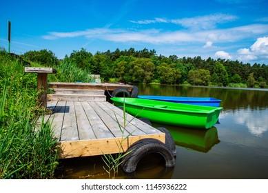 boats near wooden dock. peaceful landscape. nobody