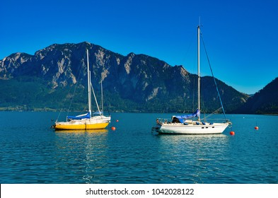 Boats on Attersee with mountain and sky in background