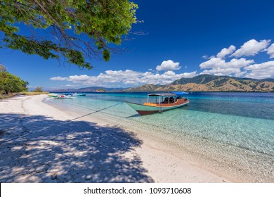 Boats on the beach on an island in the Seventeen Island National Park, Flores, Indonesia.