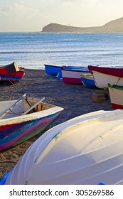 Boats on the beach in the light of the setting sun, city El Medano, Tenerife, Canary Islands, Spain.