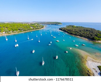 A lot of boats on the beautiful beach in Pula