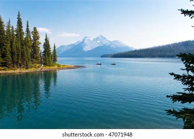 Boats on beautiful mountain lake with peak view
