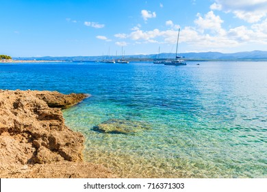 Boats on beautiful sea water near Zlatni Rat, most famous beach of Adriatic Sea, Brac island, Croatia