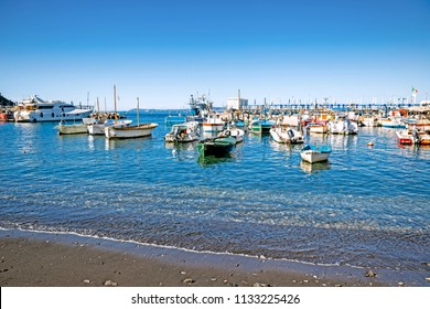 Boats on the black-sanded beach of Sorrento, Italy