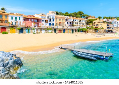 Boats on Canadell beach in Calella de Palafrugell village with colorful houses on shore, Costa Brava, Catalonia, Spain