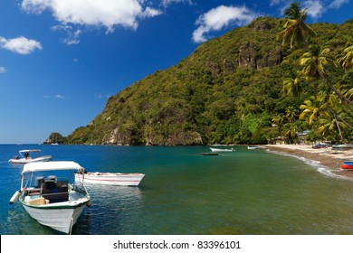 Boats on the clear waters of a beach in Soufriere in St Lucia