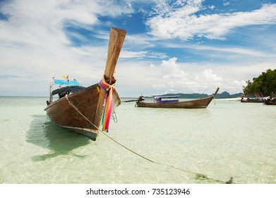 Boats on the coast of Thailand serve tourists.