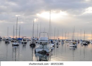 Boats on dock at the Manila Bay
