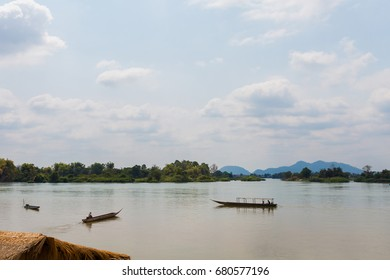Boats on Don Det island in south Laos. Landscape of nature taken on four thousands islands Si Phan Don on Mekhong river in south east asia during summer.