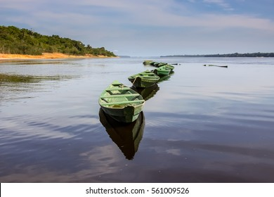 Boats on the glassy Rio Negro, Anavilhanas Archipelago, Brazil