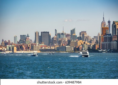 Boats on Hudson River in front of New York Skyline